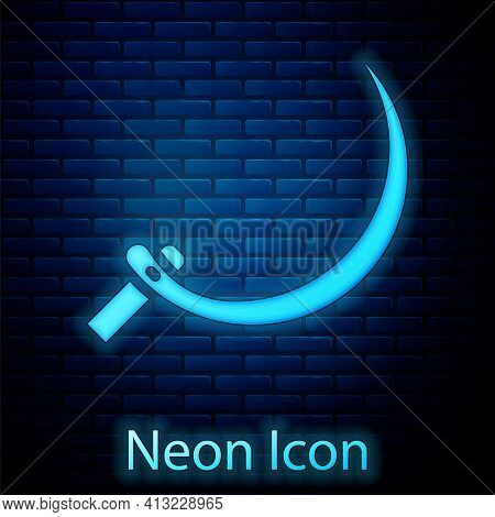 Glowing Neon Sickle Icon Isolated On Brick Wall Background. Reaping Hook Sign. Vector