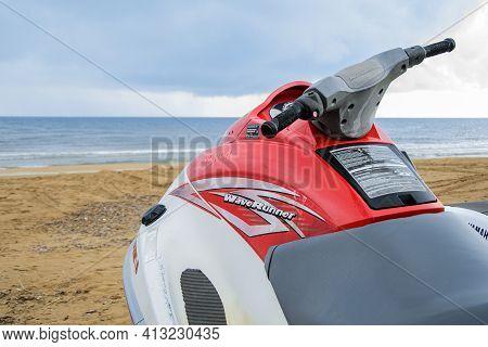 Evrenseki, Turkey - 03.15.2021 Close-up Of Helm Of Yamaha Waverunner Standing On Shore Against Backd