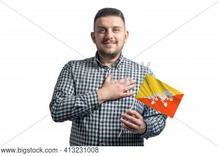 White Guy Holding A Flag Of Butane And Holds His Hand On His Heart Isolated On A White Background Wi