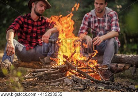 Great Time Together. Two Men Relax At Fire. Hiking And Camping. Male Friendship. Drink Beer Bonfire.