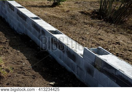 Construction Of A Concrete Wall From Concrete Blocks Filled Inside With Reinforcing Steel And Concre