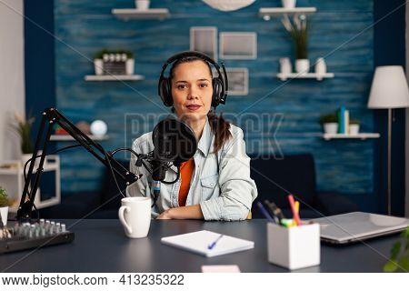 Famous Video Blogger Streaming From Home Studio Podcast Using Professional Recording Equipment. Soci