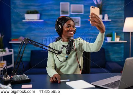 African Influencer Talking A Selfie For Listener While Recording Vlog. On-air Online Production Inte
