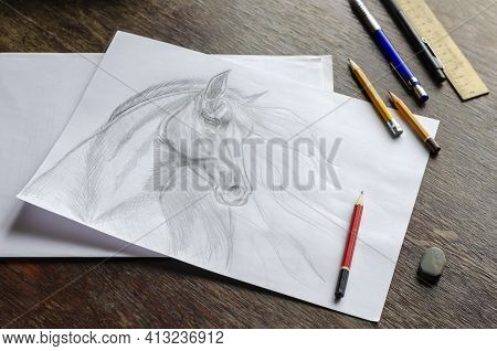 Horse Portrait Drawn In Pencil On White Paper. Monochrome Drawing Of An Animal With A Long Mane On A