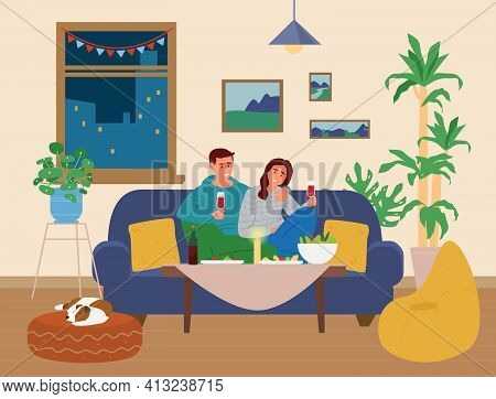 Couple Having Romantic Dinner At Home. Man And Woman Sitting At Table With Snacks On The Couch Holdi