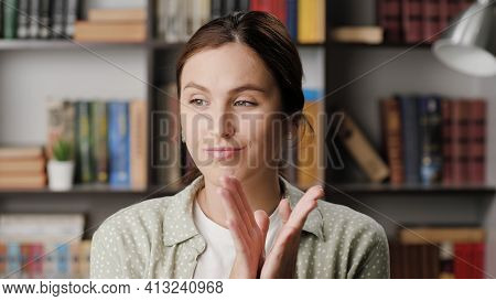 Woman Sarcastic Applause. Gloomy Skeptical Woman In Office Or Apartment Room Reluctantly Claps Her P