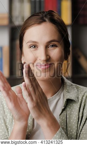 Woman Applause. Cute Positive Smiling Woman In Office Or Apartment Interior Looking At Camera And Ap