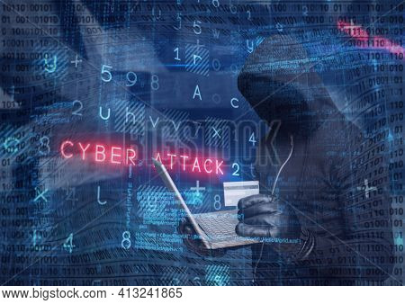 Composition of binary coding and cyber attack warning text over hacker in hood using laptop. online security cyber attack concept digitally generated image.
