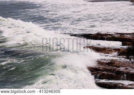 Big Waves Crashing Against Rocky Shoreline In Tasmania, Australia