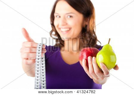 Healthy eating, woman with apple and pear and measuring tape