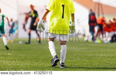 Children Football Goalkeeper On A Game. Young Boys In Goalie Uniform And Soccer Gloves. Football Goa