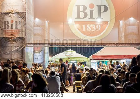 Belgarde, Serbia - August 19, 2017: Logo Of Bip Pivo Beer On A Bar In Belgrade With A Crowd Of Clien