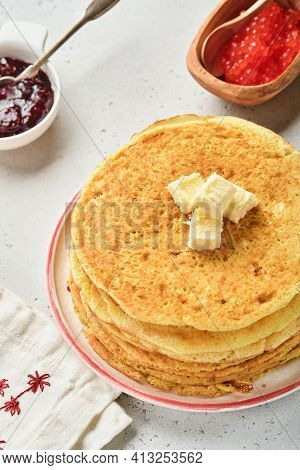 Crepes Or Thin Pancakes Stack With Butter And Raspberry Jam On Beautiful Ceramic Plate On An Old Gra