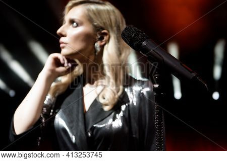 Singer Woman On Stage. Singer And Microphone.