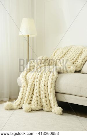 Knitted Merino Wool Plaid On Sofa In Room
