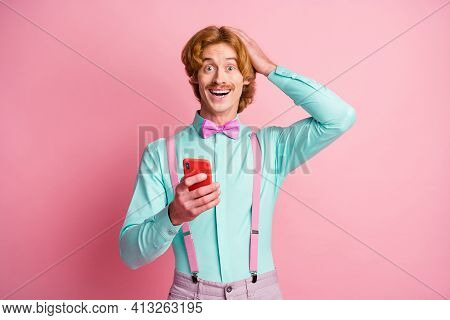 Photo Of Young Amazed Happy Positive Man Hold Hand Head Sees Unexpected Post Comment Isolated On Pin