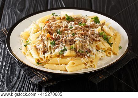 Penne Pasta Alla Genovese Sauce With Beef, Wine And Vegetables Close-up On A Plate On The Table. Hor