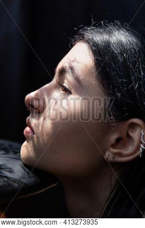 White European Woman With Dark Hair Portrait Isolated On Black