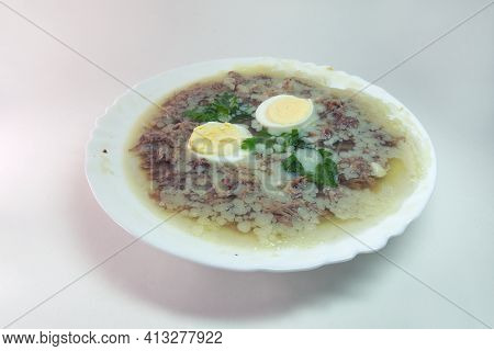 A With Meat, Eggs And Fresh Parsley, Made With Thick And Rich Nutritious Bone Broth, Frozen In Elega