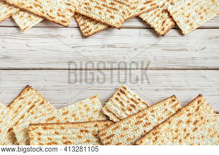Happy Passover Concept. Matzah Background. Traditional Jewish Regilious Holiday Of Pesach. Frame Mad