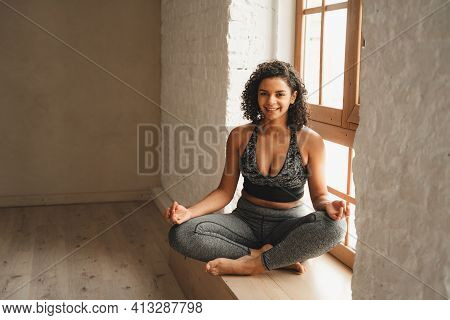 Fit Athletic Woman Doing Meditation, Self Control. Beautiful Women Working Out In Gym Together. Inte