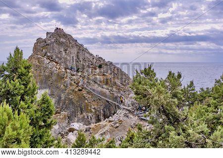 Rock Diva, The Black Sea Coast Near Yalta, Town Simeiz, Crimea. People Walk On The Suspension Bridge