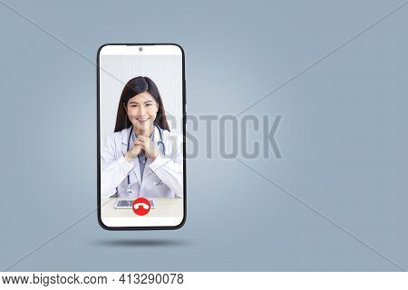Female Doctor Chatting Online With Patients. Black Smartphone Concept Connect To Communication Via O