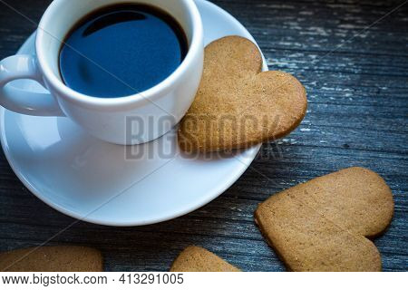 White Coffeecup With Hot Fresh Beverage And Heart-shaped Gingerbread Biscuits. Coffee Break With Lov