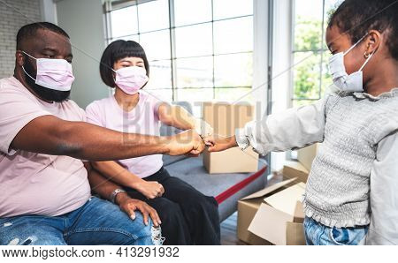 African Family Are Wearing A Surgical Masks And Fist Bump To Show The Family Team Power And Success