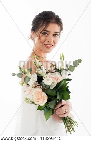 Pretty Fiancee Smiling At Camera While Holding Wedding Bouquet Isolated On White.