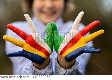 Freedom Seychelles Concept. Cute Child Forming Flying Bird Gesture With Hands Painted In Seychelles