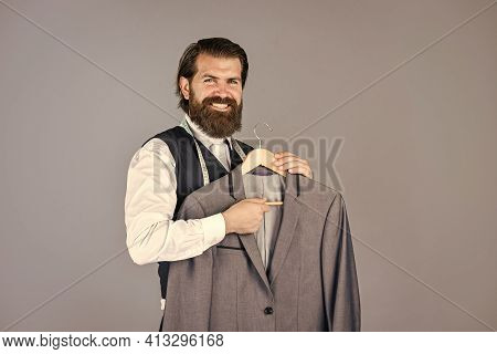 Working On New Design. Tailor In His Workshop. Handsome Bearded Fashion Man In Costume Suit. Man In