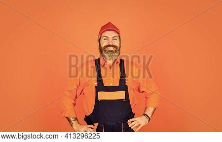 Man Wear Boilersuit. Bearded Worker In Overalls. Confident Mature Mechanic. Portrait Of Repairman. W