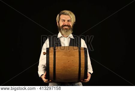 Winery Concept. Producing Wine Family Tradition. Man Bearded Hipster Wooden Barrel For Wine Black Ba