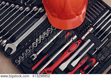 Toolbox, Tools Kit Detail And Orange Protective Helmet Close Up. Instruments. Set Of Tools. Car Tool