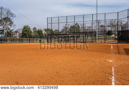 Empty Baseball Field At A Local Park Opened For Practice Standing Behind Third Base Looking Towards