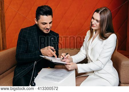 Salesmen Are Letting The Male Customers Sign The Sales Contract. Business Concept And Contract Signi