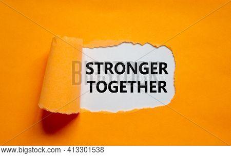 Stronger Together Symbol. Words Stronger Together Appearing Behind Torn Orange Paper. Business, Moti