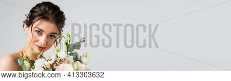 Happy Fiancee Looking At Camera While Holding Wedding Bouquet Isolated On Grey, Banner.