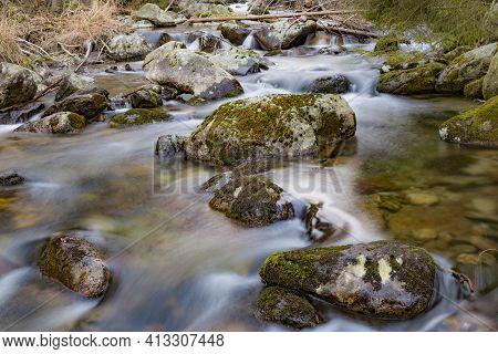 Mountain Creek. Water Among Mossy Stones Close-up. Beautiful Mountain River Landscape