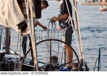 Trieste, Italy - October, 08: The Crew Of Sailboat Haul Down The Sails During The 52° Barcolana Rega