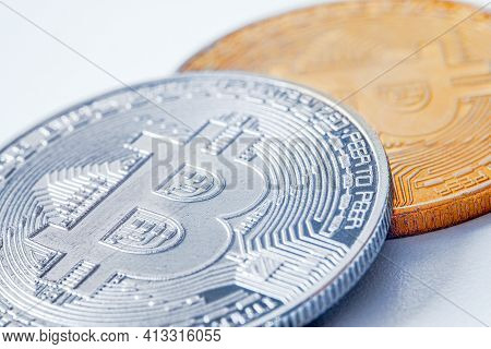Golden Coins With Bitcoin Symbol On A Mainboard.
