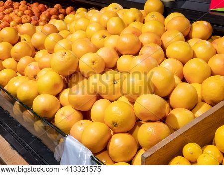 Fresh Oranges In The Store. Crates Full Of Ripe Mandarin And Clementines, Oranges For Sale At The Co