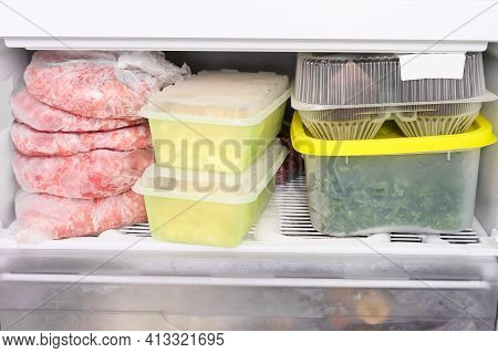 Many Different Frozen Raw Food In Containers In A Home Freezer, Meat, Vegetamles, Bread And Semies,