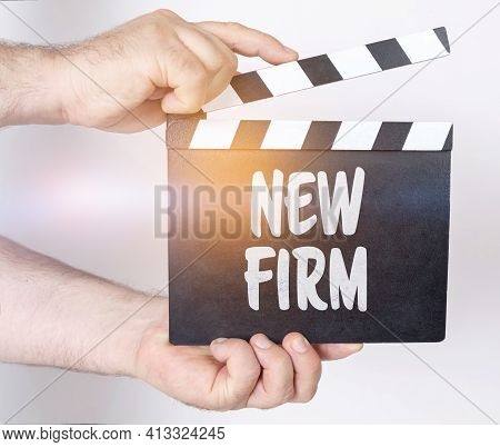 Business And Finance Concept. On A White Background, A Man Holds A Clapperboard In His Hands On Whic