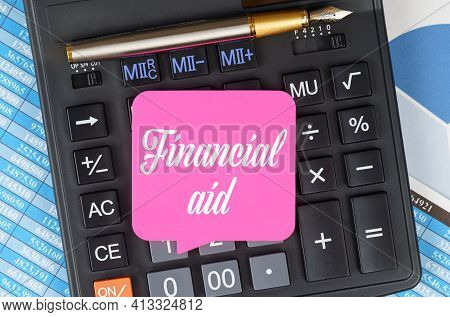 Finance And Economics Concept. On The Desktop Are Charts, Reports, A Calculator And A Sheet For Note