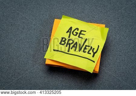 age bravely - inspirational reminder note, positivity, mindset  and aging well concept