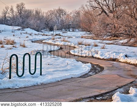 meandering  bike trail in winter scenery - one of numerous bike trails in Fort Collins, northern Colorado, recreation and commuting concept