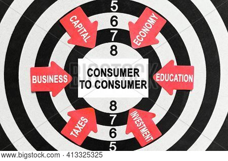 Business And Finance Concept. On The Target, Arrows With Business Lettering Point To The Center On A