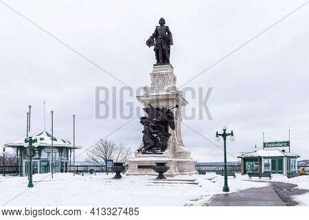 Quebec City, Quebec, Canada - 17 January 2021: The Samuel Champlain Monument Under The Snow In The